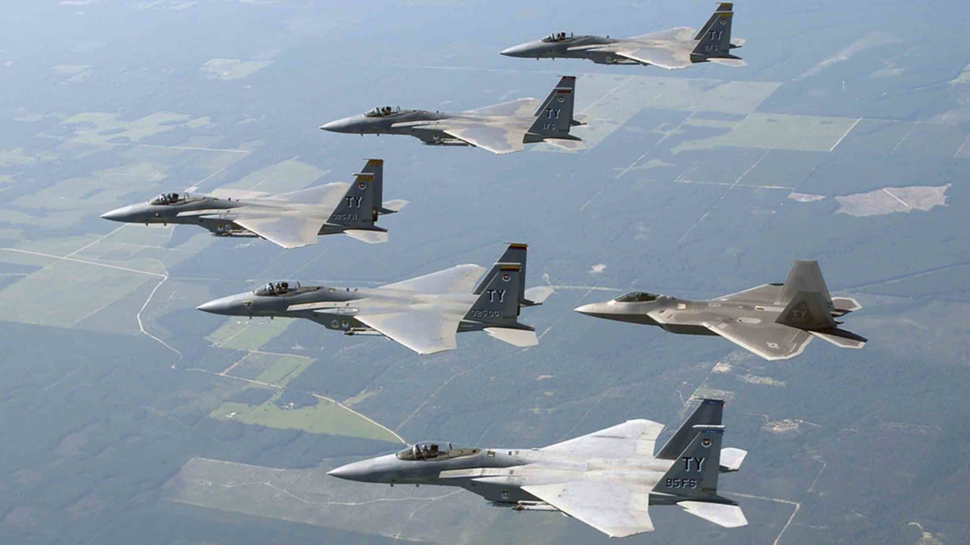 U.S. military aircraft fly in formation